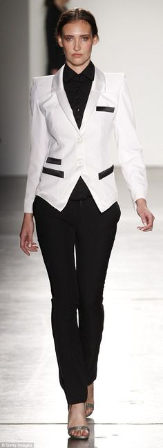 Return of the pant suit: Two black and white pant suits were showcased, paired with tailor...