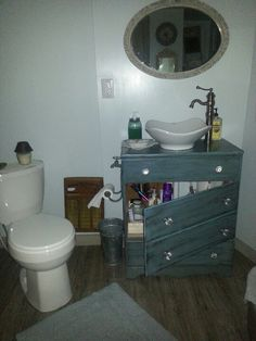 Bathroom vanity from old dresser  I like how the drawers were turned into a door