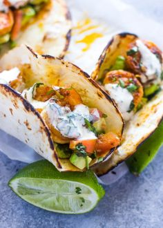 Spicy shrimp tacos with avocado salsa and sour cream cilantro sauce. These tasty tacos are ready in under 15 minutes and are super healthy and delicious!I simply couldn't find the words to e…