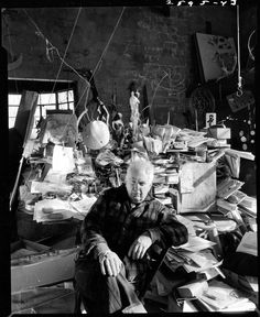 Calder's crazy, chaotic studio. (This makes me feel better about the current state of my apartment!)  Sculptor Alexander Calder in his studio, 1957