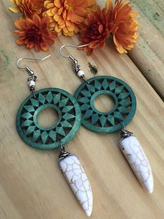 A personal favorite from my Etsy shop https://www.etsy.com/listing/490076217/tribal-wooden-hoop-and-howlite-spike