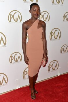 Lupita Nyong'o kept it chic in a body-hugging Stella McCartney frock at the 25th annual Producers Guild Awards. [Photo by Alberto E. Rodriguez/Getty Images]