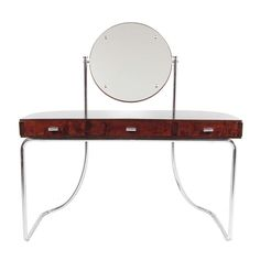 Mart Stam. Rare, all original three drawer vanity made of stained plywood with chromium-plated tubular steel frame and adjustable round mirror. Made by Fritz Hansen, ca.1931.