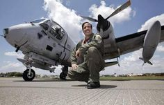 Joe Masessa and his Grumman OV-1 Mohawk. The Mohawk is a Flying Monument to Vietnam POW/MIAs as it has all 1636 of their names painted on it's sides.