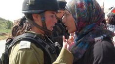 """""""GET OFF OF MY LAND!"""" A Palestinian woman facing off against a IDF soldier. Western feminists need to STOP heralding female IDF soldiers as """"feminists"""" or """"modern day Amazons"""", because these women are carrying out Israel's neo colonialist, racist, ethnocidal agenda against the Palestinian people and African immigrants. Nothing justifies committing war-crimes and genocide."""