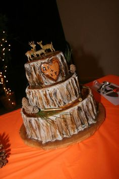 Rustic wedding cake. Log cake with deer toppers.