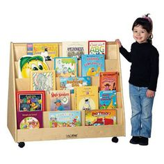 Keep all of your story time favorites neatly organized and easily accessible to the youngest child with this Double Sided Book Display. Constructed of durable, stain resistant Birch, the book display features (5) easy-to-reach shelves on each side, so it'll display books of all sizes.