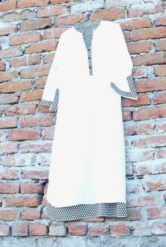 white and Black polka dot pakistani kurti.