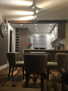 Dining Room Round Glass Dining Table Cream Futon Chair Wooden Floor Track Light Accent Mirror Kitchen Bar Window Curtain Kitchen Cabinet Flower Vase Jar How to Decorate Adjoined Kitchen-Dining Room