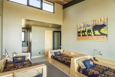 The guest house has three bedrooms, including this 'bunk' room with four built-in twin beds.