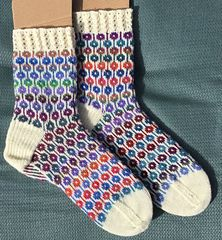 I saw this motif on a socks and a pair of mitts, so I charted out my own version. With needle cast on 80 sts. Work lace for cuff to desired length. Switch to color pattern and work 10 repe. Sock Crafts, Lang Yarns, Boot Cuffs, Yarn Needle, Knitting Needles, Leg Warmers, Color Patterns, Ravelry, Two By Two