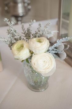 Winter wedding flowers - Small glass votive with white ranunculus - by Laurel Weddings