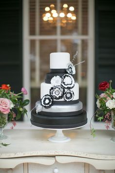 white, black and silver wedding cake