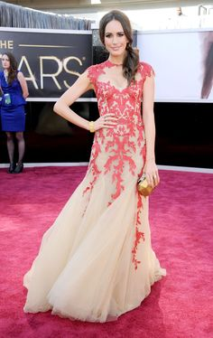 Pin for Later: Something Fishy! The Greatest Mermaid Dresses of All Time  TV presenter Louise Roe wore this crimson and cream Monique Lhuillier dress to the Oscars in 2013.