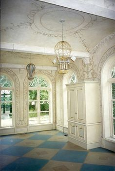 Arched floor-ceiling windows, Painted walls and ceiling, and Hot Air Balloon Fixtures