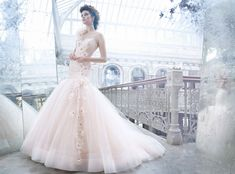 Lazaro LZ3259  Sherbet tulle bridal ball gown, sweetheart neckline, sheer elongated Alencon lace corseted bodice, silk chiffon flowers with crystal centers accent one shoulder cascading down bodice onto gathered tulle skirt, chapel train