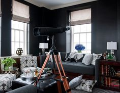 Go Dark-Dark walls do the opposite of what you'd expect: They make a small room feel bigger.    The tower room in this New York apartment is by designers Kristen Fitzgibbons and Kelli Ford.