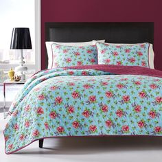 This fun reversible quilt set by Betsey Johnson offers a floral print on a solid background. The pink and blue tones bring the look together.