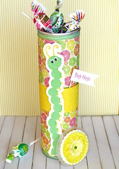 Recycled Pringles Can using Cricut Stretch Your Imagination. I want to do this with Christmas paper for my aides.