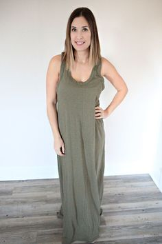 The Tawny Dress is an olive colored tank style maxi dress.
