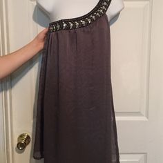 Rue 21 blouse UP FOR SALE IS A GREY COLORED RUE 21 BLOUSE/ SHORT DRESS WITH EMBELLISHMENTS AROUND THE NECKLINE. SIZE SMALL. 100% POLYESTER. BRAND NEW WITH TAGS. COMES FROM A SMOKE FREE HOME Rue 21 Tops Blouses