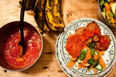 Akara with pepper salsa and a spring salad    Akara are black-eyed bean fritters that are very popular from Nigeria to Sierra Leone.  I prepared a light carrot and courgette salad to add an extra splash of colour, and fried the Akara when my guests arrived so that they were warm and crispy.