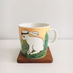 "Vintage Arabia Finland ceramic mug named "" Ylioppilas"", designed by Heljä Liukko-Sundström, 1998, Made in Finland"