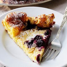 "Oven-Puffed Pancake with Berries by Two Tarts... "" Just pour it in, bake it and this pancake emerges from the oven with a warm custardy center. And with berries of your choice .... just sprinkle with powdered sugar... and enjoy."""