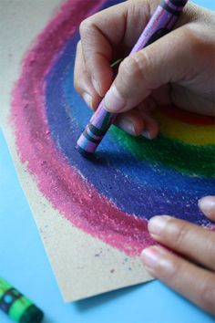 Draw on sandpaper with crayolas, iron the image on to a t-shirt.