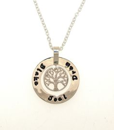 Sterling silver, medium Kanjo Halo with hanging Tree of LIfe. Hand-stamped with the names of your loved ones. Designed and handcrafted in our workshop www.randbsutherland.com.au #Kanjo #personalisedjewellery #gold #sterlingsilver #treeoflife #jewellery #pendant #rogersworkshop #clarevalley #randbsutherland