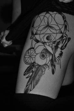sweet dream catcher tattoo. I would get this in full color. Blue butterfly and maybe red feathers and a light pink for the flower.