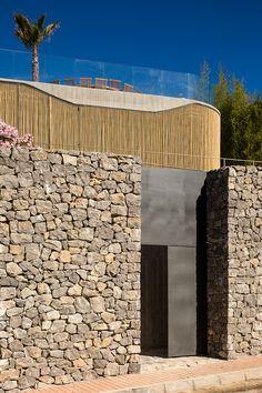 italian architecture studio metroarea has constructed a multi-storey residence on the spanish island of ibiza.