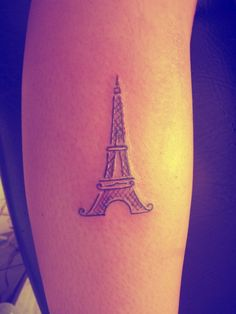 Tattoo: Tour Eiffel wherever i go to do mission work i want a tatoo for the place i do for the longest!! mabye paris.  a little  word paris under the loop on the bottom in cursive mabye.