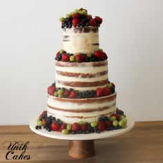 2017 Wedding Cake Trends: Naked Cakes. Semi-naked wedding cake with fresh fruit and berries. Made by Philly Bakery Unik Cakes. #phillyweddingcakes #phillyweddings