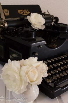 Vintage Typewriter with white roses