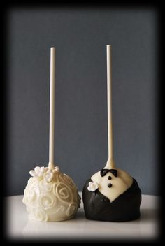 These bride and groom pops, plus a pop for each bridesmaids and best man. Bridesmaids would be the color of the dresses and the best men also in tuxes. (: