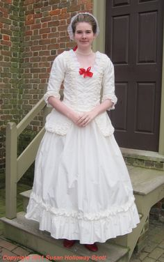 Christmas in Colonial Williamsburg, 2011: A new white silk gown for one of the manuta-maker's assistants. More: http://twonerdyhistorygirls.blogspot.com/2011/12/christmas-in-colonial-williamsburg_28.html#