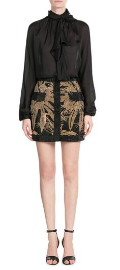Coated with gold-tone beads, this black cotton mini skirt is packed with attitude and edge - as is signature to Balmain's indulgent aesthetic.  The high hemline makes it a statement choice for nights out, just add a structured blazer and tall stilettos #Stylebop