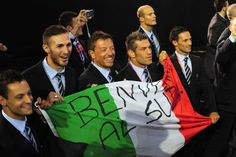 """Italy delegation during the Opening Ceremony of London 2012. They have written """"Benvenuti al sud"""" on the flag, """"Welcome to the south"""""""