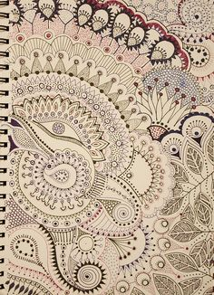 A page filled with doodles. I like that they used different coloured pens. It makes it more interesting.