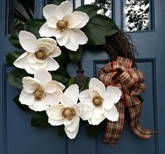 Holiday Off-White Magnolia Wreath with Plaid Ribbon.   use poinsettia or any other large flower