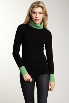 nice turtle neck in black with green collar and cuffs