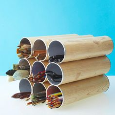 Short mailing tubes are a great way to store art supplies. See more ideas here: http://www.bhg.com/home-improvement/storage/sneaky-storage-solutions-for-every-little-thing/?socsrc=bhgpin081712mailtubestorage