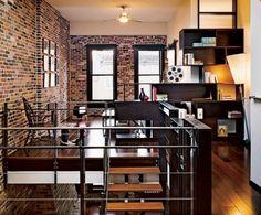 Brick, wood floors,  black frames on windows, and metal railings always appeal in urban environments. Loft living.