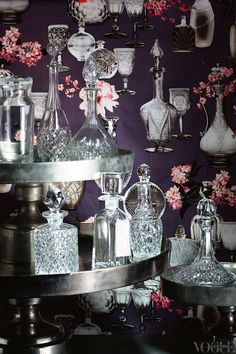 crystal decanters with similar accented wallpaper backdrop. Perfect.