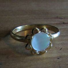 White Iridescent Ring $$OBO$$ Band is adjustable.   CLOSET CLEAR OUT! Taking all offers as long as they are made using the button! Also bundling for a bargain with 20% off 2 or more! Jewelry Rings