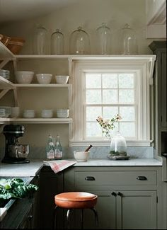 site with several grey kitchens.  LIKE the shelf above the window!!!!