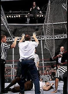 The Undertaker after choke slamming Mankind through Hell in a Cell at King of the Ring the most dangerous entity ever to step into a WWE ring. Watch Wrestling, Wrestling Stars, Wrestling Wwe, Harley Davidson, Undertaker Wwe, Mick Foley, Catch, Wwe Tna, Wwe World