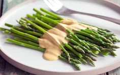 Vegan Hollandaise Sauce - This savory, rich sauce is a great stand-in for traditional egg and butter hollandaise. Serve warm over a tofu frittata, on sliced tomatoes and toast or spooned over steamed veggies.