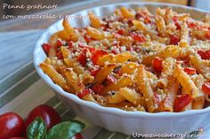 Penne gratinate con mozzarella e pomodoro